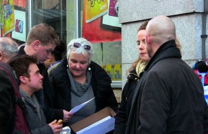 distributing leaflets or chatting